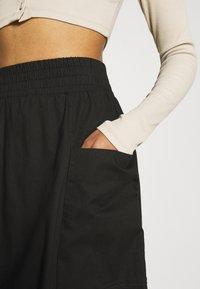 Monki - QIA SKIRT - Áčková sukně - black dark - 5