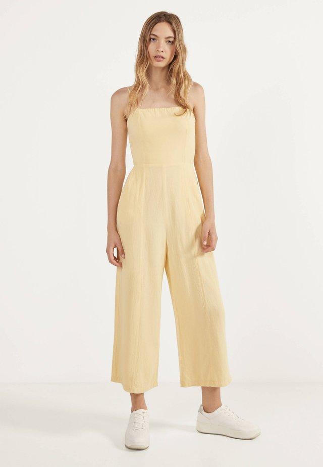 MIT BINDEKNOTEN - Tuta jumpsuit - yellow