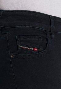 Diesel - SLANDY-LOW-ZIP - Jeans Skinny Fit - dark blue - 6