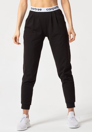 LUCKY JOGGERS - Tracksuit bottoms - black