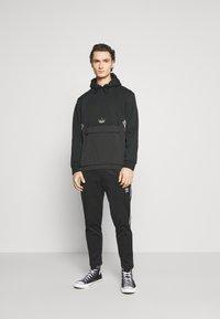 adidas Originals - HOODY - Sweatshirt - black - 1