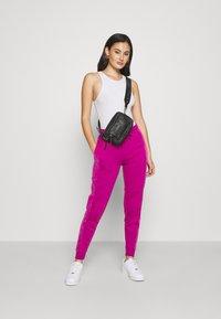 Nike Sportswear - HRTG VELOUR - Tracksuit bottoms - cactus flower - 1