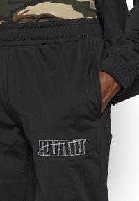 Puma - GRAPHIC TRACKSUIT - Trainingsanzug - black - 7