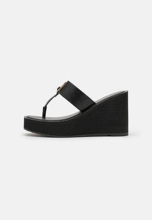 ACARENIA - T-bar sandals - black