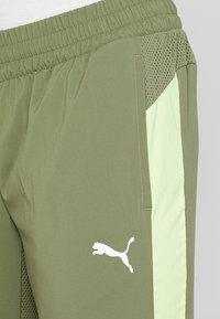 Puma - ENERGY PANT - Pantalon de survêtement - olivine/yellow - 3