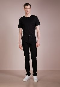 McQ Alexander McQueen - STRUMMER  - Jeans Skinny Fit - darkest black - 1