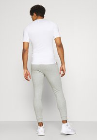 Nike Performance - PANT TAPER - Tracksuit bottoms - dark grey heather/black - 2