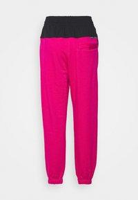 Nike Sportswear - Tracksuit bottoms - fireberry/black/white - 8