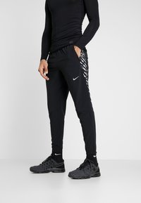 Nike Performance - WOVEN PANT - Teplákové kalhoty - black/silver - 0