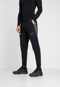 Nike Performance - WOVEN PANT - Verryttelyhousut - black/silver - 0