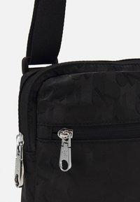 Calvin Klein Jeans - MICRO REPORTER - Taška spříčným popruhem - black - 4