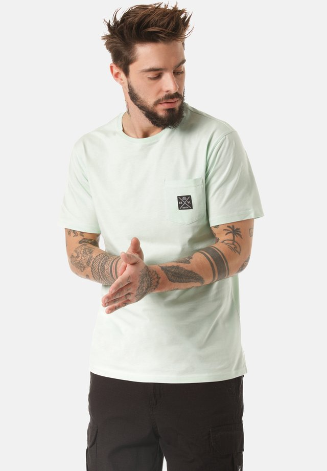 MOUNTAIN T-SHIRT MATOPO - Basic T-shirt - green