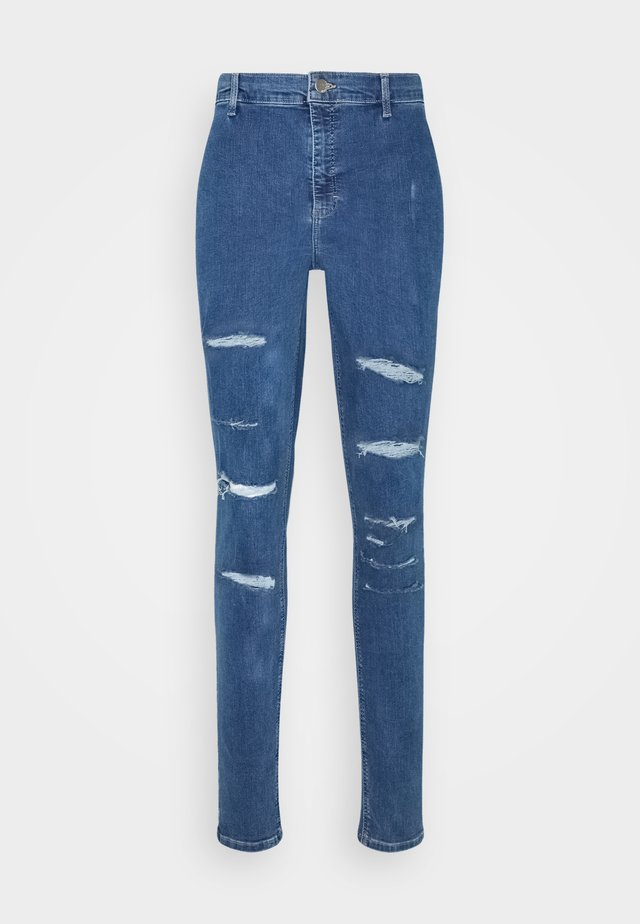 Jeansy Skinny Fit - mid denim