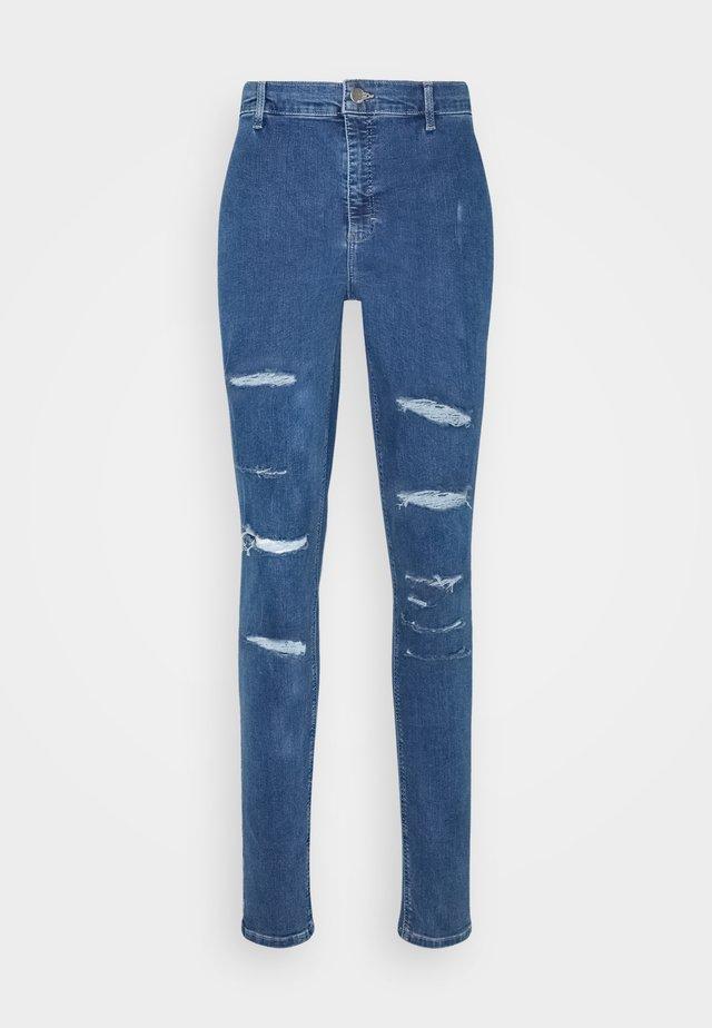 Skinny džíny - mid denim