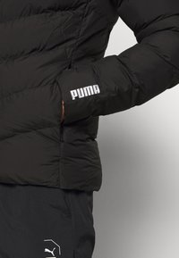 Puma - WARMCELL LIGHTWEIGHT JACKET - Winterjas - black - 4
