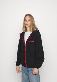 Ellesse - BOLAZIONI WINDRUNNER - Summer jacket - black - 0