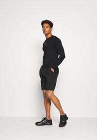 Calvin Klein Golf - BASE LAYER WITH PRINTED CK LOGO - T-shirt à manches longues - black - 1