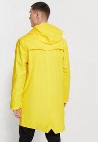 Rains - UNISEX LONG JACKET - Impermeable - yellow - 2
