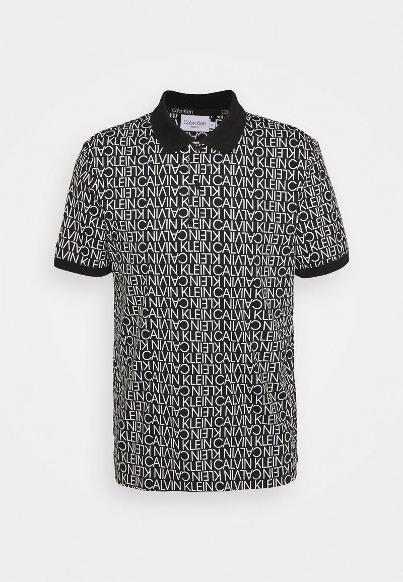 Calvin Klein - LIQUID TOUCH ALLOVER LOGO - Polo shirt - black