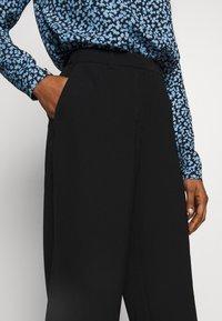 Selected Femme - SLFMAYA FLARED SLIT PANT - Stoffhose - black - 3