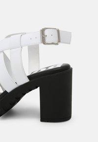 Buffalo - VEGAN RAGAN - Platform sandals - white - 7