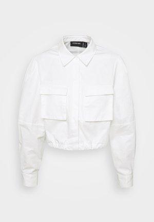 THE SHADOW SHIRT - Button-down blouse - white