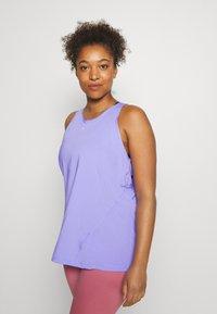 Nike Performance - TANK ALL OVER PLUS - Sports shirt - light thistle/(white) - 0