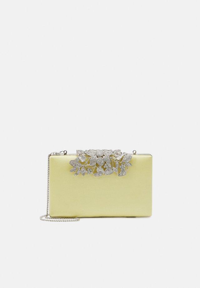 CHARLOTTE - Clutch - pastel yellow/silver