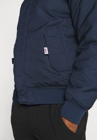 Tommy Jeans - TECH BOMBER UNISEX - Winter jacket - twilight navy - 10