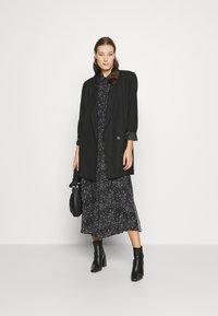 Mavi - PRINTED DRESS - Maxi-jurk - black - 1