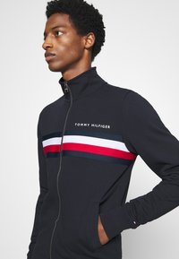 Tommy Hilfiger - LOGO ZIP THROUGH - Zip-up hoodie - blue - 4