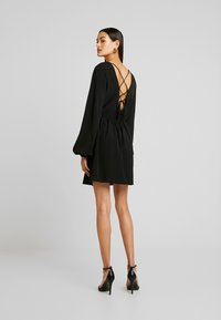 Nly by Nelly - VOLUME BACK FOCUS DRESS - Day dress - black - 3