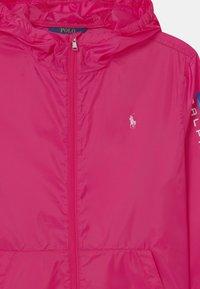 Polo Ralph Lauren - PACKABLE OUTERWEAR - Lehká bunda - sport pink - 2