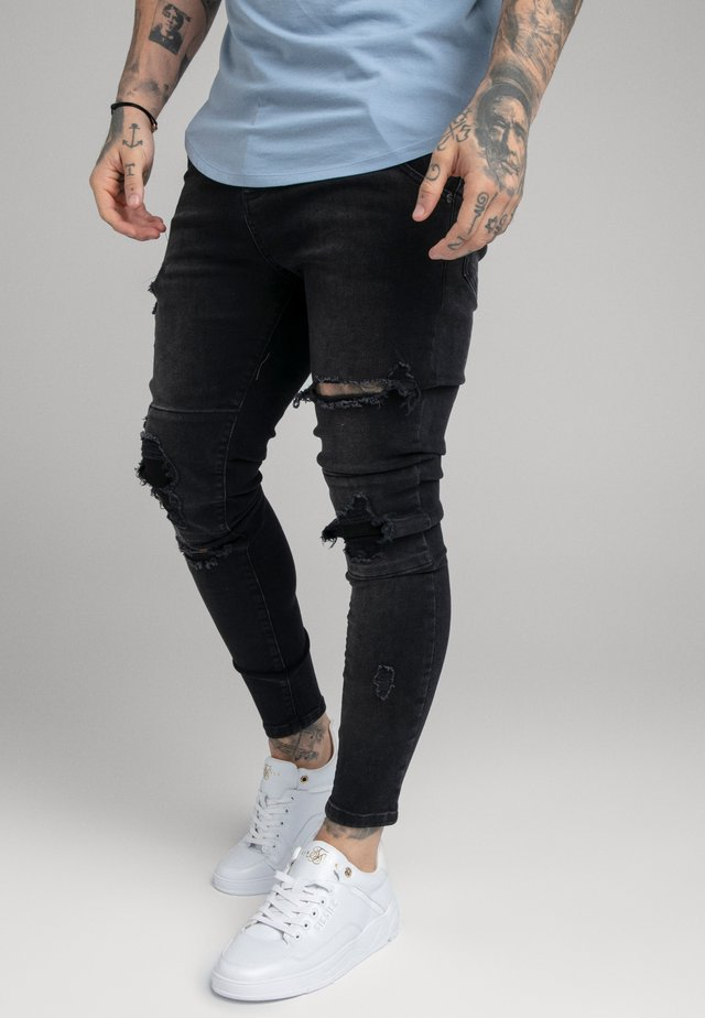 DISTRESSED PATCH - Jeans Skinny - washed black