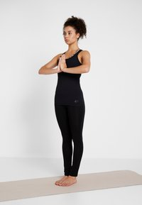 Curare Yogawear - TANK - Débardeur - black - 1