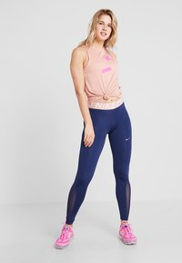 Nike Performance - Leggings - midnight navy/red bronze - 1