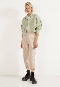 Bershka - Trousers - mottled beige - 1