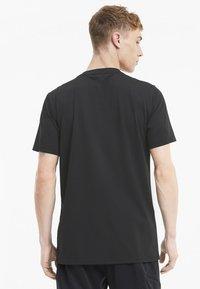 Puma - THERMO - Print T-shirt - puma black - 2
