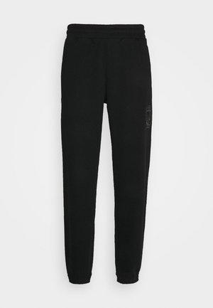 COLLEGIATE CREST UNISEX - Tracksuit bottoms - black