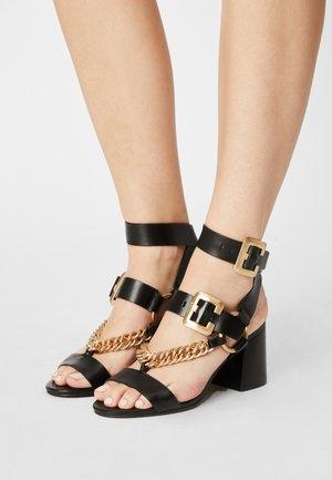 JAGG-ER - Sandals - black