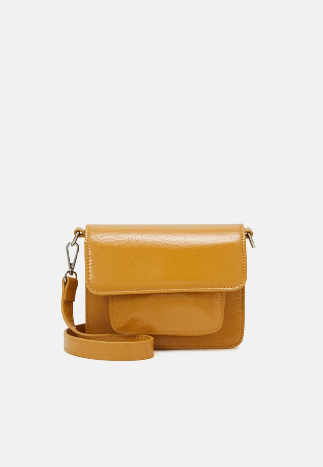 CAYMAN MINI GLOSSY - Across body bag - mustard