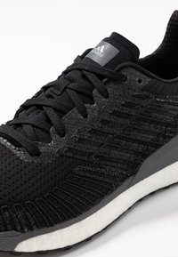 adidas Performance - SOLAR BOOST 19 - Zapatillas de running neutras - core black/carbon/grey five