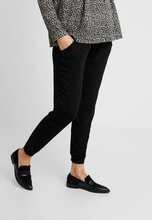 OVERBUMP - Teplákové kalhoty - black