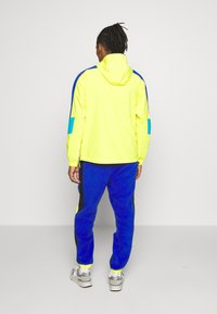 The North Face - EXTREME PANT - Tracksuit bottoms - blue combo - 2
