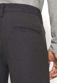 Selected Homme - SLHSLIM STORM FLEX SMART PANTS - Trousers - dark grey - 5