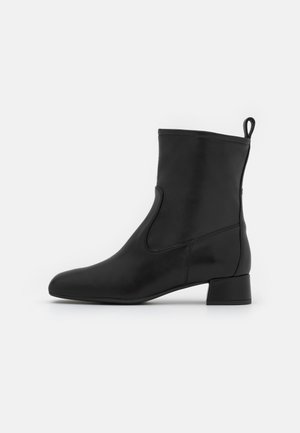 GLIDE - Classic ankle boots - black