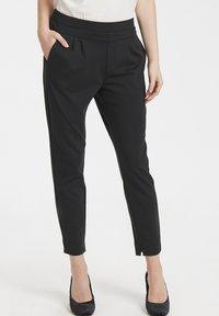 Cream - ANETT PANTS - Trousers - pitch black - 0
