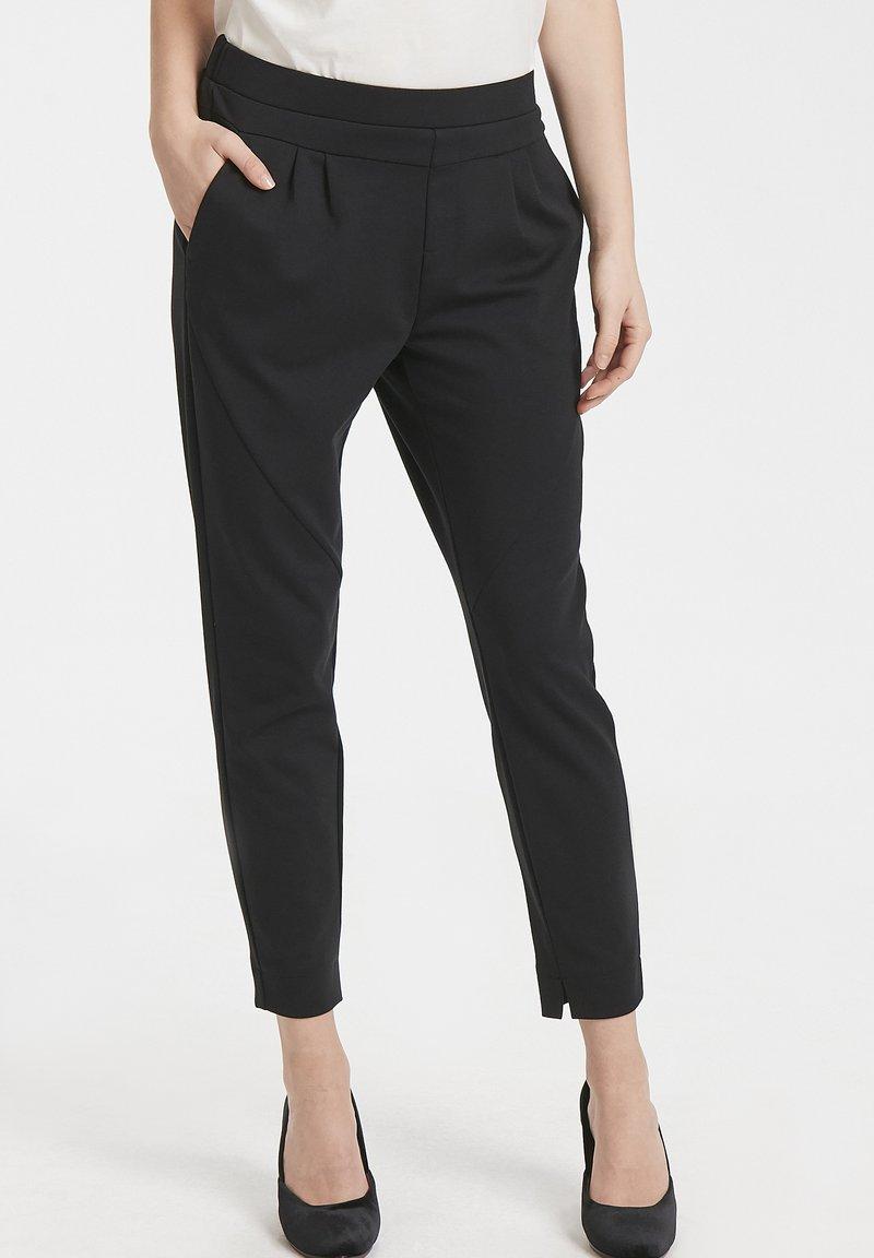 Cream - ANETT PANTS - Trousers - pitch black