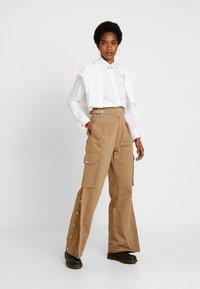 Diesel - CHIKU - Spodnie materiałowe - beige - 2