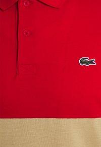 Lacoste - Piké - rouge/viennois marine - 2